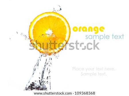 orange splash into fresh water with sample text - stock photo