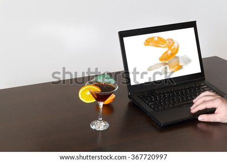Orange splashes milk on different devices monitor