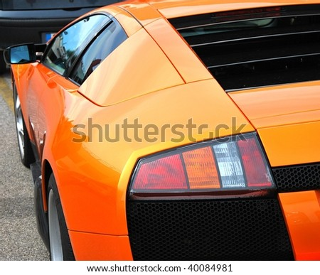 Orange sport car. - stock photo