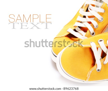 orange sport shoes over white (with sample text) - stock photo