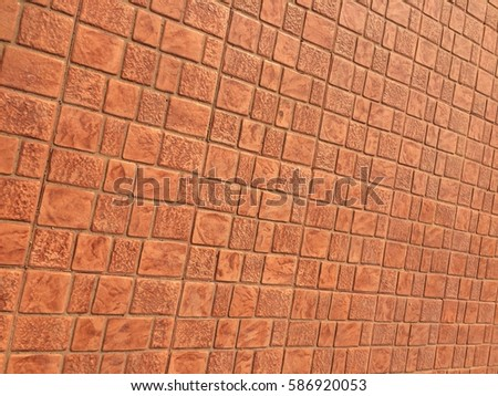 Orange stamp concrete floor texture pattern background