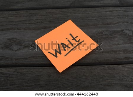 Orange sticker with the inscription wait