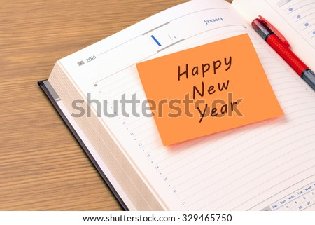Orange sticky note on a new year 2016 office organizer. Happy New Year   - stock photo