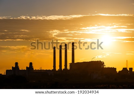 Orange sunset and cloud over gas turbine  electrical power plant - stock photo
