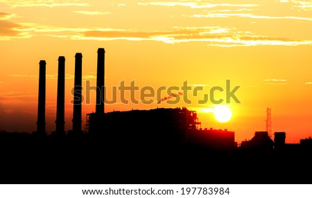 Orange sunset and cloud over gas turbine  electrical power plant