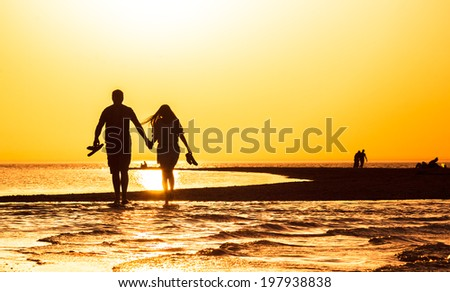Orange sunset over the sand spit in the sea  in the summer evening - stock photo