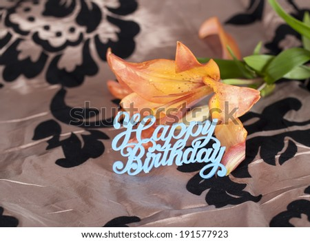 Orange tiger lily with happy birthday sign