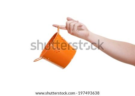 Orange tin basket isolated on white - stock photo