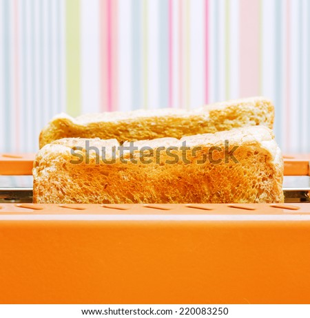 Orange toaster with two slices of bread. - stock photo