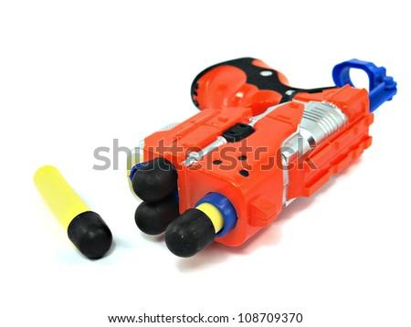 orange toy dart gun on a white background - stock photo