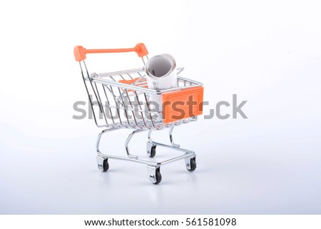 Orange Trolley With Receipts Over White Background