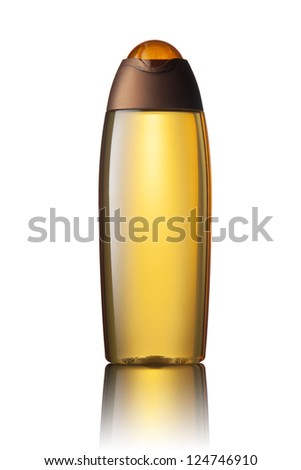 Orange tube bottle of shampoo, conditioner, hair rinse, gel, soap, on a white background with reflection. - stock photo