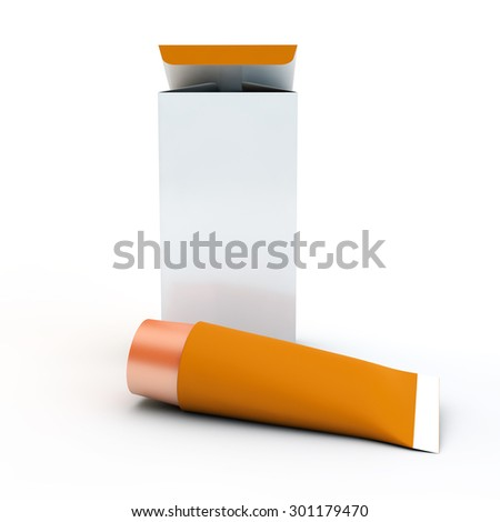 orange tube for cream or toothpaste near cardboard packing - stock photo