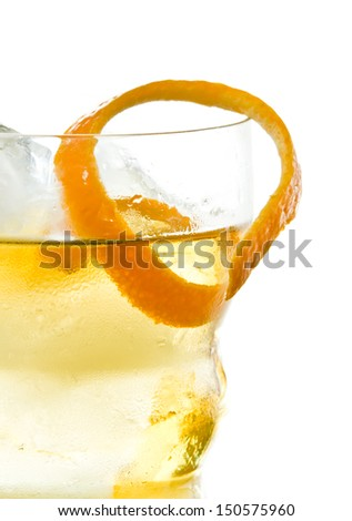 orange twist, cocktail garnish isolated on a white background
