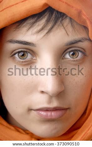 orange veil woman with beautiful eyes, studio picture - stock photo