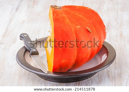Orange vibrant pumpkin with seeds - stock photo
