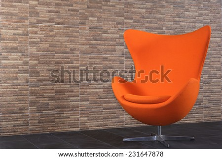 Orange vintage style recycled sofa in my room. - stock photo