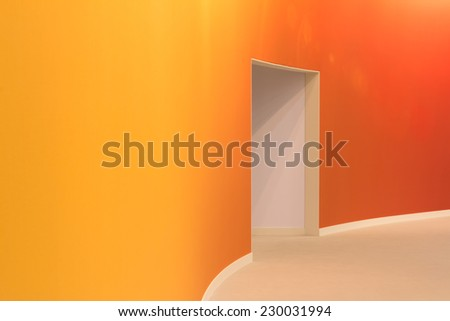 orange wall and open entrance in a empty room - stock photo