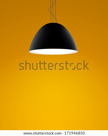 orange wall with black ceiling lamps - stock photo