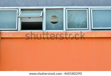 orange wall with one windows glass open