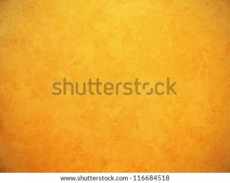 Orange wallpaper with rough surface texture. - stock photo