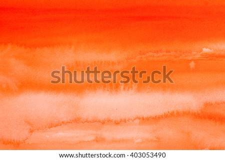 orange warm watercolors on textured paper surface - design element - abstract background