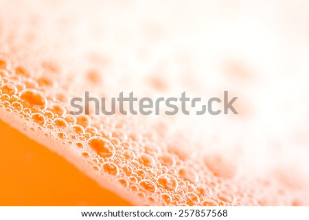 orange water drops close up - stock photo