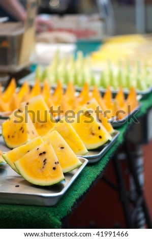 Orange watermelon on sale at a street market in Tokyo, Japan.