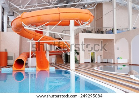 Stock photo orange waterslide indoor pool 249295084