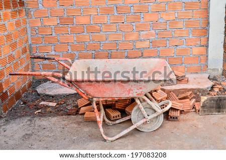 orange Wheelbarrow - stock photo