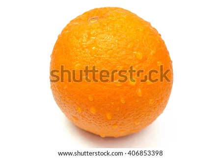 orange with drops of water on the skin - stock photo