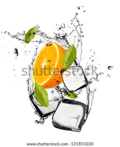 Orange with ice cubes, isolated on white background - stock photo