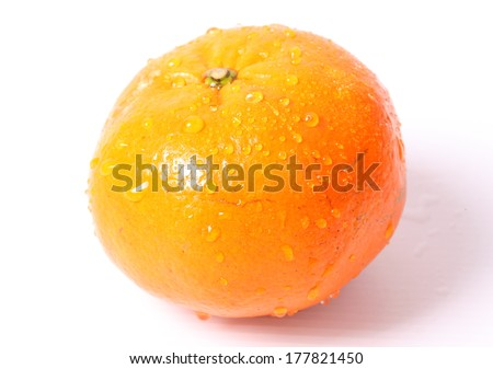 Orange with water drops on a white background - stock photo