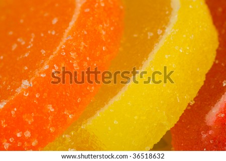 Orange, yellow and red sugar citrus candy