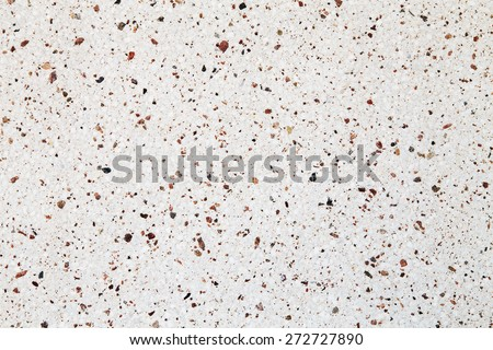 Orange, yellow, red, blue colorful stones and pebbles on a white wall, background, closeup - stock photo