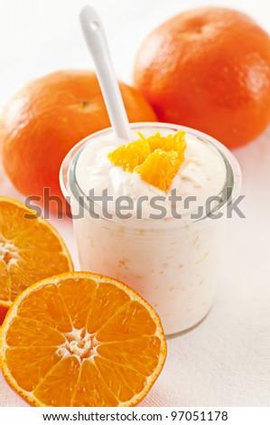 Orange Yoghurt with fresh fruits - stock photo