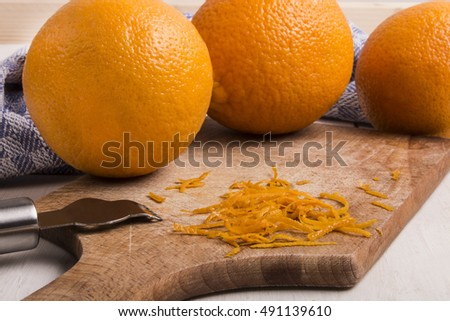 orange zest, top layer of an orange peel, it contains the fruit oil and adds a bright citrus flavor to many dishes