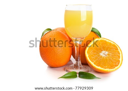 oranges and a glass of juice isolated on a white background