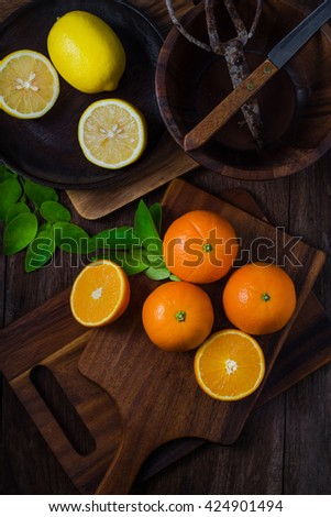Oranges and lemons with leaves on wooden background. orange. lemon orange fruit. lemon fruit. orange juice. lemon juice.  - stock photo