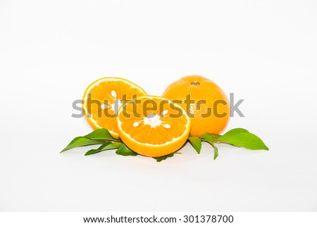 Oranges and on a white background. Some are orange fruits cut in half. Some slight blurred. - stock photo