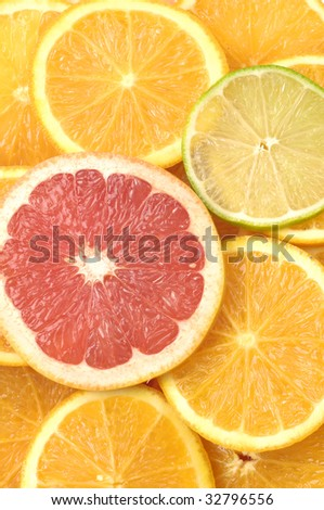 Oranges grapefruits and lemons slices background