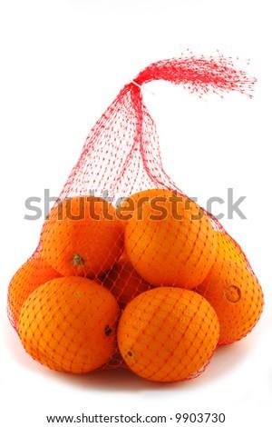 Oranges in mesh bag series - stock photo