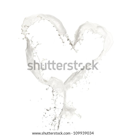 Oranges in milk splash, isolated on white background - stock photo