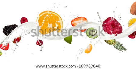 Oranges in milk splash, isolated on white background - stock photo