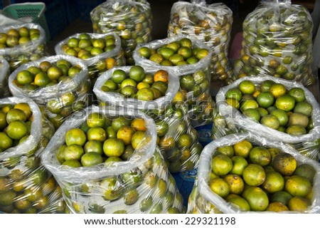 oranges in plastic bag - stock photo