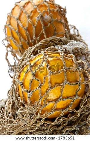 Oranges in vintage string-bag - stock photo