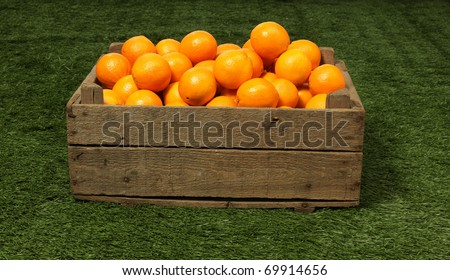 oranges in wooden box - stock photo