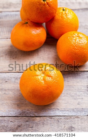 oranges on textured weathered wooden table