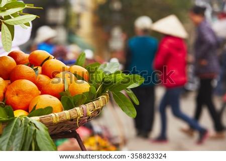 Oranges on the street market in Hanoi - Vietnam - stock photo