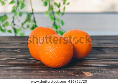 Oranges on the Wooden Table Healthy Lifestyle Concept